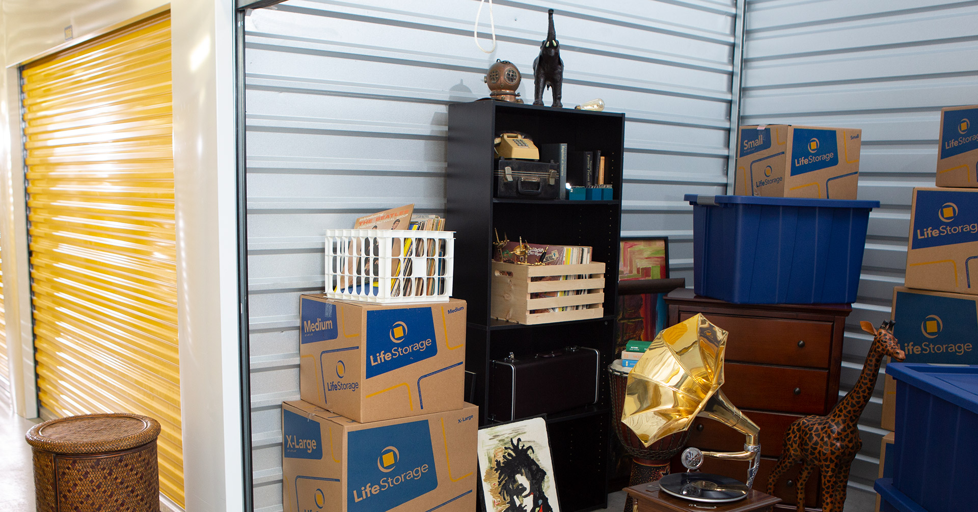 10x15 storage unit with trophies, boxes and other belongings