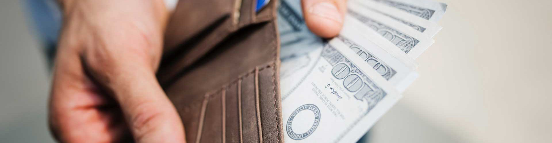 Man holding dollar bills getting security deposit back