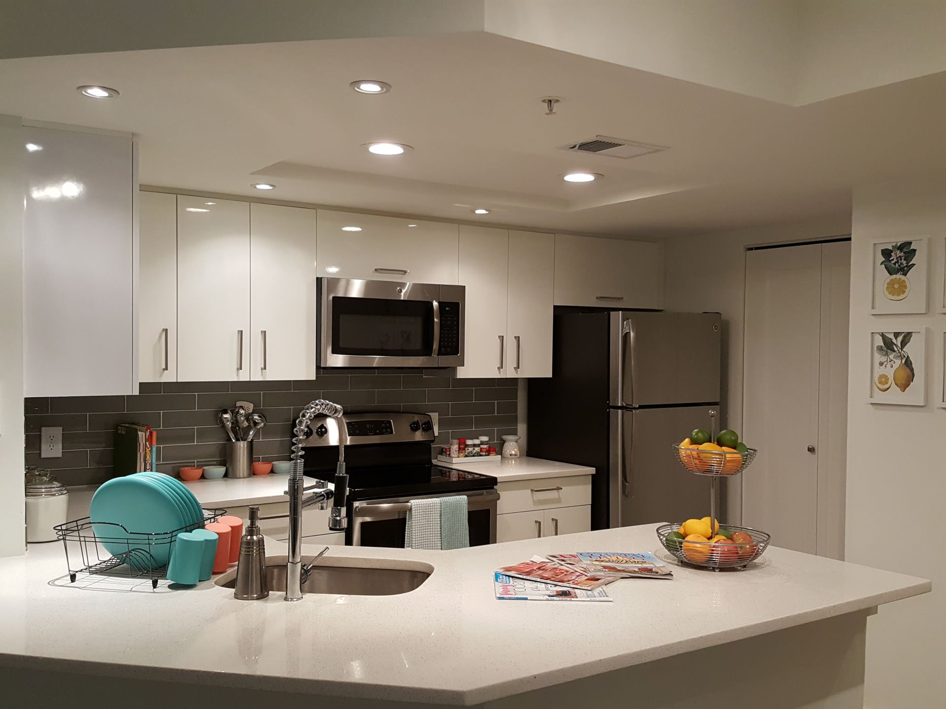 Clean White Kitchen with Organized Countertops and Teal Accents